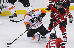 May 6, 2012; Newark, NJ, USA; New Jersey Devils center Adam Henrique (14) defends against Philadelphia Flyers center Danny Briere (48)  during the first period in game four of the 2012 Eastern Conference semifinals at the Prudential Center.
