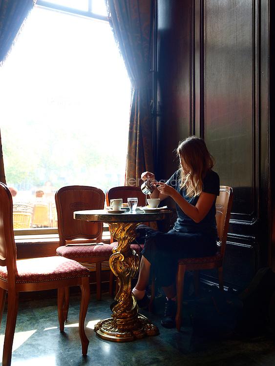 A customer at café Gerbeaud, Budapest, Hungary.