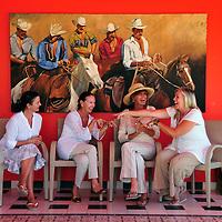 (from right) Lisa Harper, Jenny Armit, Sandra Scandiber and  Esther Ammann meeting at Rancho Pescadero Hotel, Pescadero, near Todos Santos, Baja California Sur, Mexico