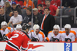 Mar 13, 2013; Newark, NJ, USA; Philadelphia Flyers head coach Peter Laviolette watches the action during the second period of their game against the New Jersey Devils at the Prudential Center.