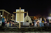 """PRAYER SERVICE — Marquette University students gather outside of the St. Joan of Arc Chapel to begin a human rights outdoor stations of the cross. The evening stations of the cross were indented to integrate the passion of Jesus with the human rights sufferings around the world. As part of the university's Mission Week, events were held to mark the theme, """"Human Dignity, Human Rights: A Call to Service."""" (Photo by Sam Lucero)"""