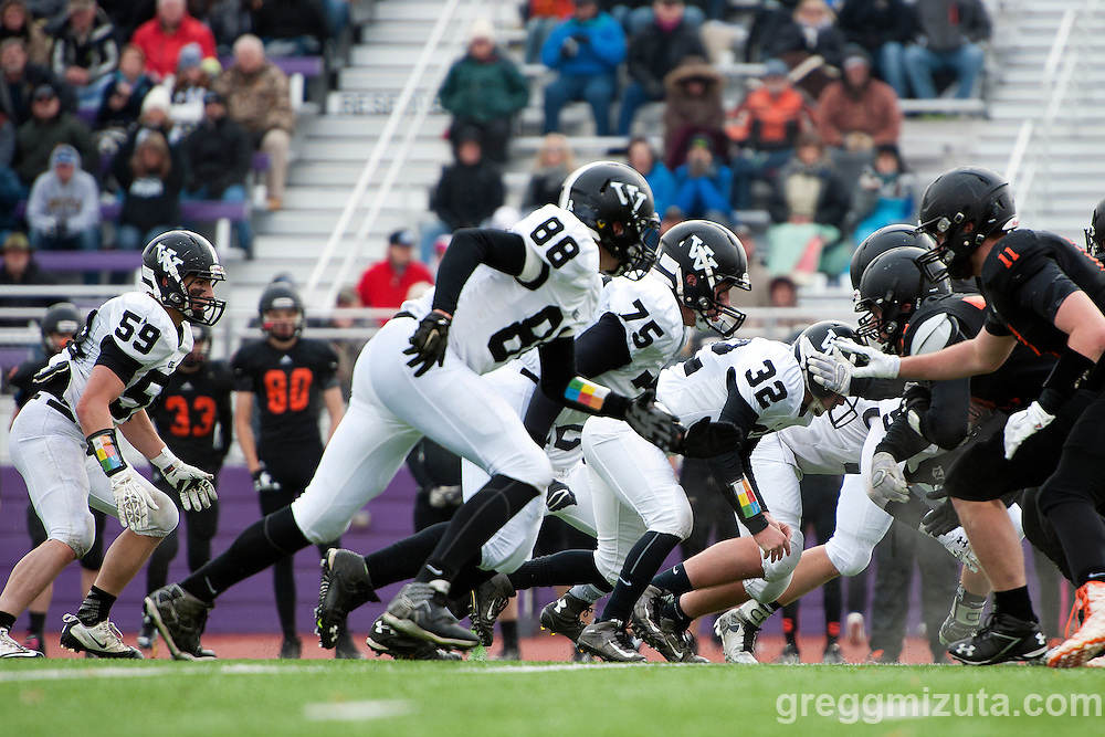 Vale defense (L to R: Garret DeVos, Cody Towers, Trey Lowe, McKay Bennett) during the first quarter of the 3A semifinal playoff game against Scio at Kennison Field, Hermiston, Oregon, Saturday, November 21, 2015. Vale won 42-14.
