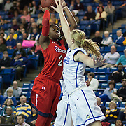 St. John&rsquo;s Forward Amber Thompson (2) takes a jumps shot as Delaware Guard Courtni Green (2) defends in the second half of a NCAA regular season non-conference game between Delaware (CAA) and St. John's (Big East) Monday, Dec 30, 2013 at The Bob Carpenter Sports Convocation Center in Newark Delaware.<br /> <br /> St. John's (8-4) defeats Delaware (8-3) 61-58
