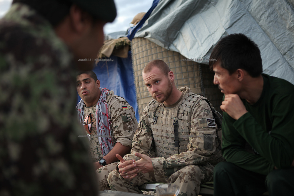 A german ISAF lieutenant talks to afghan commanders in The Combat Outpost Quatliam. In late October 2011 Kunduz based 3.Task Force started a several days operation in and around Nawabad (District Chahar Darah), west of Kunduz, northern Afghanistan. During the Operation Orpheus about 100 german infantery soldiers rolled out for patrols through the town and surrounding areas, which were expected as a retreat zone of insurgents.