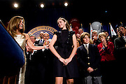 California Governor Arnold Schwarzenegger's wife Maria Shriver, left, introduces their children Christina, center, and Christopher, right, during a GOP victory party at the Beverly Hilton in Beverly Hills, CA on Tuesday, November 7, 2006.