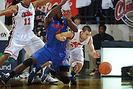 "Florida's Patrick Young (4) and Mississippi's Marshall Henderson (22) go for the ball at the C.M. ""Tad"" Smith Coliseum in Oxford, Miss. on Saturday, February 22, 2014. Florida won 75-71.  (AP Photo/Oxford Eagle, Bruce Newman)"