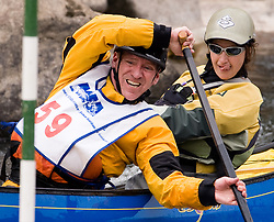 Tom McGregor (front) of Madison, Wisconsin and MIchelle Grimm of Medford, Wisconsin race in the OC2 mixed class during the slalom course of the 42nd Annual Missouri Whitewater Championships. McGregor and Grimm placed second place in the class. The Missouri Whitewater Championships, held on the St. Francis River at the Millstream Gardens Conservation Area, is the oldest regional slalom race in the United States.