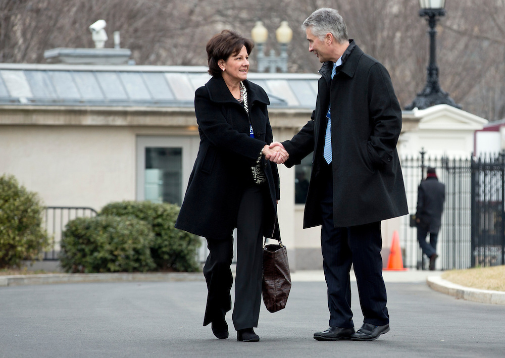 Monica Lozano, CEO, Impremedia and Jeff Smisek, Chairman and CEO, United Continental shake hands as they arrive to meet with U.S. President Barack Obama and other CEOs on a variety of topics including immigration reform and how it fits into his broader economic agenda, and his efforts to achieve balanced deficit reduction at the White House in Washington February 5, 2013.      REUTERS/Joshua Roberts    (UNITED STATES)