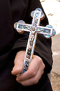 The Via Dolorosa Procession, Jerusalem, Israel, Good Friday Easter 2005 A close up of a hand holding a cross