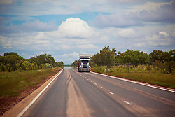 A roadtrain drives along the main highway from Derby to Broome in the wet season.