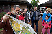 Tourists at a morning brief before the safari at the Ngorongoro Conservation Area or NCA is a conservation area situated 180 km west of Arusha in the Crater Highlands area of Tanzania.