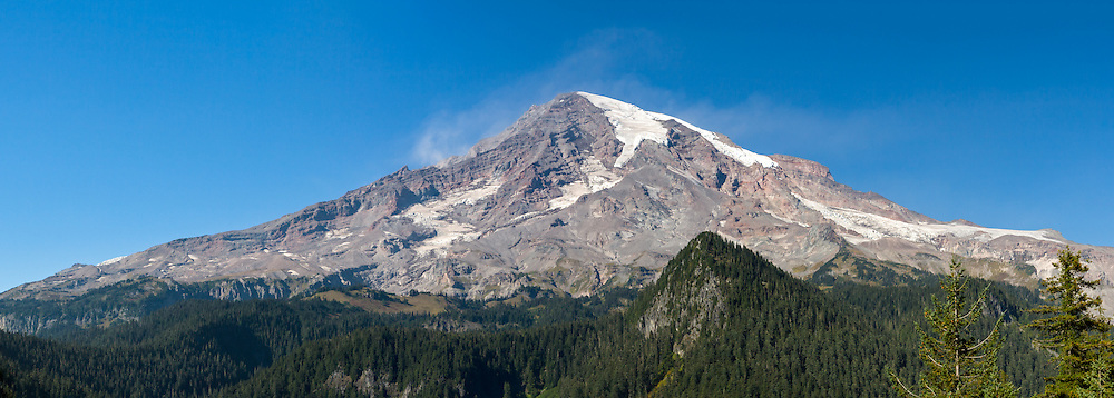Dust blowing off the peak of Mount Rainier in Mount Rainier National Park, Washington State, USA.  Photographed from Ricksecker Point, the Cushman Crest is in the middle right.