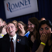 Romney supporter Natasha Abdullah reacts after seeing that Rick Santorum led Mitt Romney during a caucus night event with other Romney supporters at the Hotel Ft. Des Moines Tuesday, January 3, 2012, in Des Moines, IA...Photo by Khue Bui