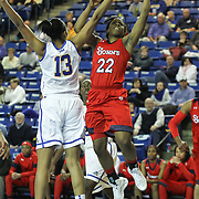 St. John's Guard Eugeneia McPherson (22) drives to the basket as Delaware Center Kelsey Buchanan (13) defends in the second half of a NCAA regular season non-conference game between Delaware (CAA) and St. John's (Big East) Monday, Dec 30, 2013 at The Bob Carpenter Sports Convocation Center in Newark Delaware.