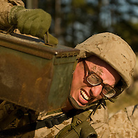 Marine Corps recruit James Plummer lifts heavy ammo cans during the obstacle course at Parris Island, S.C., on Nov. 24, 2007. (Photo by Stacy L. Pearsall)