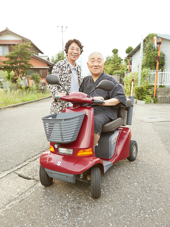 Lifestyle image of senior couple with senior scooter in Japan