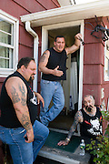 "Rescue Ink, Long Island, New York, taettowierte Motoradgang, Verein zur Rettung mishandelter Hunde und anderer Tierarten.vlnr:.""Big Ant"", Joe Panz, ""Batzo""..Rescue Ink, the animal rescue group that brings an in your face approach to the fight against animal abuse and neglect. The goups members are heavily tattooed and ride motorbikes. Their pitbull 'Rebel', who lives at their headquarters, was rescued from a dog fighting operation, where he was used as bait. He was near death when two members of Rescue Ink flew to Virginia to save him..Foto © Stefan Falke."