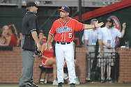 Mississippi head coach Mike Bianco discusses a call with umpire Scott Mattingly during a game against Louisiana-Lafayette in an NCAA Super Regional game in Lafayette, La. on Sunday, June 8, 2014. Mississippi won 5-2.