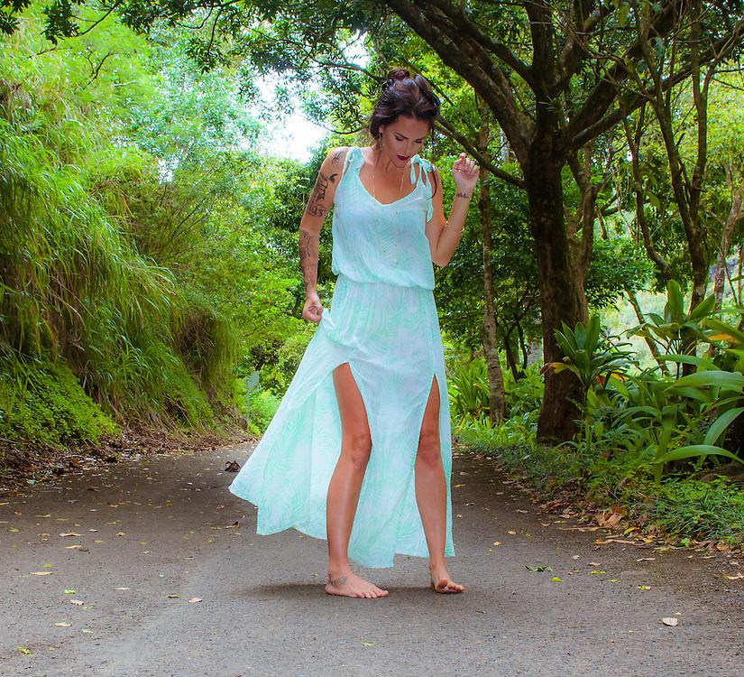 Woman on the bike path on North Shore of Oahu in Hawaii wearing a light blue Tiare Hawaii Dress. <br /> www.tiarehawaii.com<br /> Model Jessica Surratt