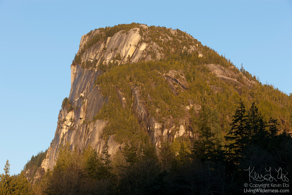 Stawamus Chief, a 702 meter (2,303 foot) granite dome, towers over the nearby town of Squamish, British Columbia, Canada. Geologists believe Stawamus Chief is a remnant of a magma chamber that was once well below the Earth's surface. Slow moving molten magma cooled and turned into granite deep below the surface and was gradually exposed by erosion over tens of millions of years.