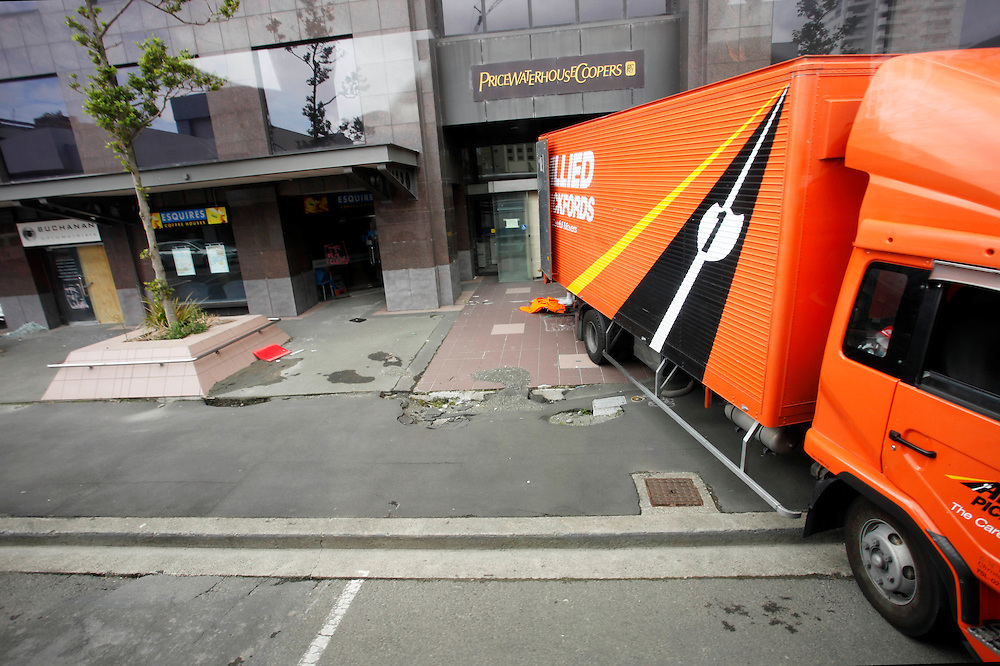 Moving truck at the Price Waterhouse Coopers Building on Armagh Street in the earthquake damaged Red Zone, Christchurch, New Zealand, Wednesday, February 15, 2012.  Credit:SNPA / Pam Johnson