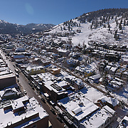 SHOT 3/2/17 11:25:20 AM - Aerial photos of Park City, Utah. Park City lies east of Salt Lake City in the western state of Utah. Framed by the craggy Wasatch Range, it's bordered by the Deer Valley Resort and the huge Park City Mountain Resort, both known for their ski slopes. Utah Olympic Park, to the north, hosted the 2002 Winter Olympics and is now predominantly a training facility. In town, Main Street is lined with buildings built primarily during a 19th-century silver mining boom that have become numerous restaurants, bars and shops. (Photo by Marc Piscotty / © 2017)