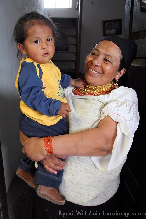 South America, Ecuador, Peguche. An Ecuadorian grandmother beams as she holds baby girl.