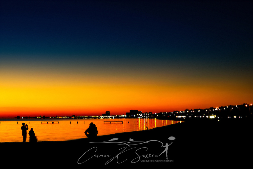 People gather to take pictures as the sun sets on Biloxi Beach in Biloxi, Mississippi, Nov. 24, 2012. (Photo by Carmen K. Sisson/Cloudybright)