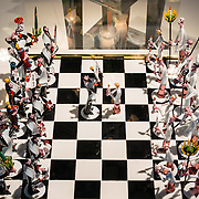"""Chess Set (1981) of Jewish (Hasidim) versus Roman Catholic (Franciscan) figures, made by master glassblower and flameworker Gianni Toso (born 1942). The fascinating Corning Museum of Glass (CMOG.org) covers the art, history and science of glass, brought to life through live glassmaking demonstrations, offered all day, every day, in Corning, New York, USA. The not-for-profit museum was founded in 1951 by Corning Glass Works (now Corning Incorporated) and has a collection of more than 45,000 glass objects, some over 3500 years old, the """"world's best collection of art and historical glass."""""""