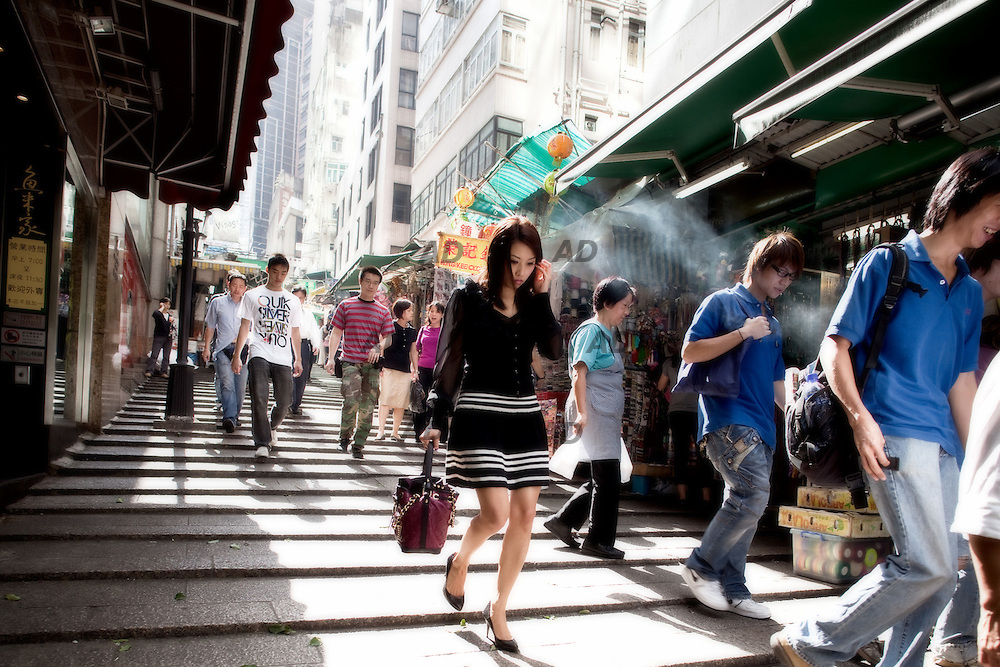 "Old pedestrian streets, Central, Hong Kong Island. *** General Caption *** Hong Kong - referred to officially as the ""Hong Kong Special Administrative Region"" by the Chinese government - was under British administration from 1842 until a transfer of sovereignty to the People's Republic of China in 1997. Today, the region operates with a great degree of autonomy under the Sino-British Joint Declaration, which provides for semi-autonomous status until at least 2047. Hong Kong's sovereignty is protected by the declaration except in areas regarding national defense and foreign relations, which are overseen by China's national government in Beijing. The region's status as China's wealthiest urban center is owed in large part to the nature of its highly capitalist economy, which boasts free markets, low taxation and government non-intervention. An important center for international finance and trade, Hong Kong - which lacks natural resources and has little arable land - operates via an economy dominated by services, which accounts for over 90 percent of the region's gross domestic product."