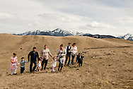 Three sisters and families, walking, foothills of Absaroka Mountains, southwest of Livingston, Montana