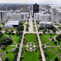 Downtown from Louisiana State Capitol Observation Tower in Baton Rouge, Louisiana<br /> In the center of this grassy courtyard in Baton Rouge is a tribute to Huey Long. Also known as The Kingfish, this progressive yet controversial governor advocated redistributing wealth from the rich to the poor towards the end of the Great Depression. His radical ideas came to an abrupt end in 1935 when he was assassinated inside the towering Louisiana Capitol Building he helped to build. This south view is from 350 feet on the 27th floor of the observation deck.
