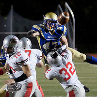 September 16, 2013 - Adam Straughn knocks down a pass from cross town rival Worcester Polytech QB Friday night at Worcester State. (MATT WRIGHT)