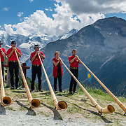 """Hear an alpenhorn concert at Alp Languard, reached via chairlift above Pontresina in Upper Engadine, in Graubünden (Grisons) canton, Switzerland, the Alps, Europe. The Swiss valley of Engadine translates as the """"garden of the En (or Inn) River"""" (Engadin in German, Engiadina in Romansh, Engadina in Italian)."""