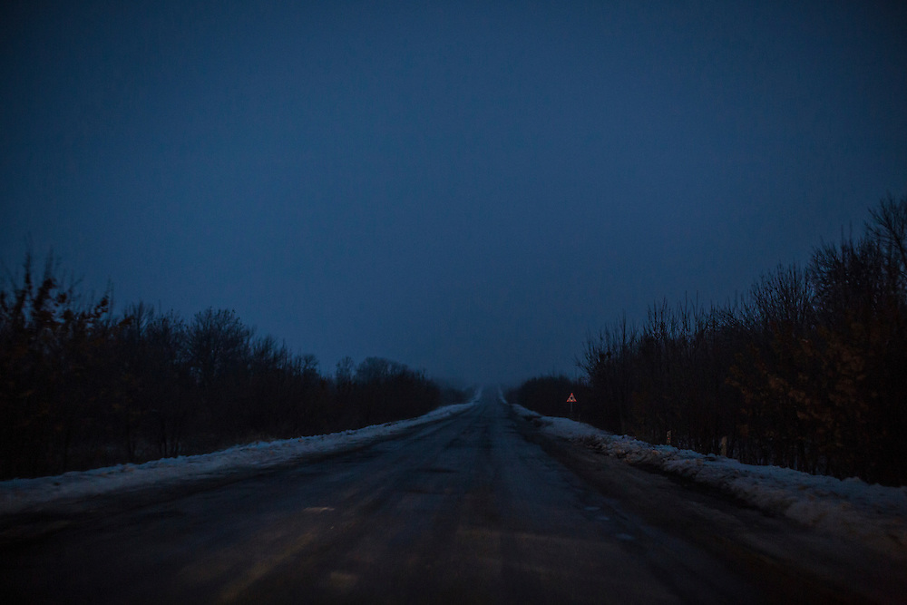 KRASNYI LUCH, UKRAINE - DECEMBER 8, 2014: A snow-covered road near Krasnyi Luch, Ukraine. CREDIT: Brendan Hoffman for The New York Times