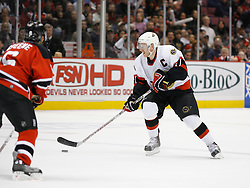 April 26, 2007; East Rutherford, NJ, USA; Ottawa Senators right wing Daniel Alfredsson (11) skates in on New Jersey Devils defenseman Andy Greene (6) during the second period at Continental Airlines Arena in East Rutherford, NJ.