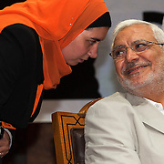 Egyptian Islamist presidential candidate Abdul Moneim Aboul Fotouh speaks with one of his campaign workers during an appearance at a womens' conference May 15, 2012 in the Nasr City district of the Egyptian capital, Cairo. Fotouh's campaign has managed to gather momentum in the final weeks of the campaign by drawing support from a broad coalition of groups including Islamists, revolutionary youth, and women. (Photo by Scott Nelson)