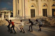 Port-au-Prince, Ouest, HAITI, 22/03/2011:  Haitian boys practicing inline skate in Port-au-Prince streets. (photo: Caio Guatelli)