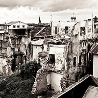Stone Town, Zanzibar 05 November  2010<br /> Old buildings of Stone Town.<br /> Stone Town or Mji Mkongwe, in Swahili meaning &quot;ancient town&quot;, is the old part of Zanzibar City, the capital of the island of Unguja, informally known as Zanzibar, part of Tanzania. The town was the centre of trade on the East African coast between Asia and Africa before the colonization of the mainland in the late 19th century after which the focus moved to Mombasa and Dar es Salaam. From 1840 to 1856, Said bin Sultan had the capital of the Omani Empire in Stone Town. The main export was spices and particularly cloves. For many years Stone Town was a major centre for the slave trade; slaves were obtained from mainland Africa and traded with the Middle East. The town also became a base for many European explorers, particularly the Portuguese, and colonizers from the late 19th century. David Livingstone used Stone Town as his base for preparing for his final expedition in 1866. A house, now bearing his name, was lent by Sultan Seyyid Said. Immigrant communities from Oman, Persia and India lived here. <br /> Photo: Ezequiel Scagnetti