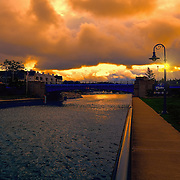 &quot;Fire in the Sky over Charlevoix&quot;<br /> <br /> Amazing sky drama walking in the town of Charlevoix Michigan just after sunrise.