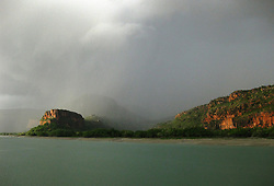 Storm bring rain to Porosus Creek in the Hunter River on the Kimberley coast.