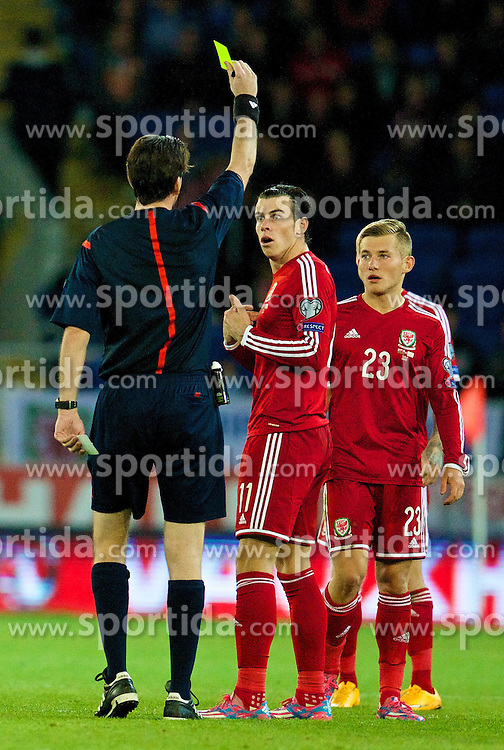 13.10.2014, City Stadium, Cardiff, WAL, UEFA Euro Qualifikation, Wales vs Zypern, Gruppe B, im Bild Wales' Gareth Bale is shown a yellow card by referee Manuel Grafe against Cyprus // 15054000 during the UEFA EURO 2016 Qualifier group B match between Wales and Cyprus at the City Stadium in Cardiff, Wales on 2014/10/13. EXPA Pictures &copy; 2014, PhotoCredit: EXPA/ Propagandaphoto/ David Rawcliffe<br /> <br /> *****ATTENTION - OUT of ENG, GBR*****
