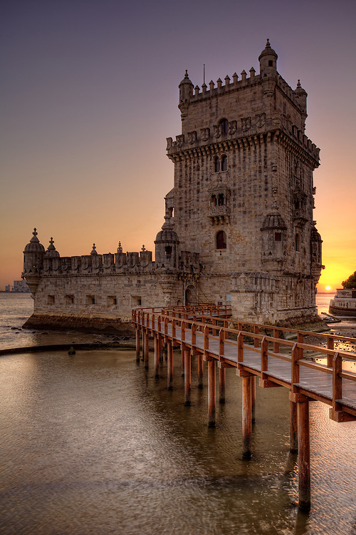 The Belem Tower is a fortified tower located in the civil parish of Santa Maria de Belém in the municipality of Lisbon, Portugal. It is a UNESCO World Heritage Site because of the significant role it played in the Portuguese maritime discoveries of the era of the Age of Discoveries. The tower was commissioned by King John II to be part of a defines system at the mouth of the Tagus river and a ceremonial gateway to Lisbon. It was built in the early 16th century and is a prominent example of the Portuguese Manueline style. The structure was built from lioz limestone and is composed of a bastion and a 30m (100 foot) tower. It has incorrectly been stated that the tower was built in the middle of the Tagus and now sits near the shore because the river was redirected after the 1755 Lisbon earthquake. In fact, the tower was built on a small island in the Tagus River near the Lisbon shore.