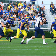 University of Maine quarterback Marcus Wasilewski (7) is flushed out of the pocket by delaware defense during a Week 6 NCAA football game against Delaware.
