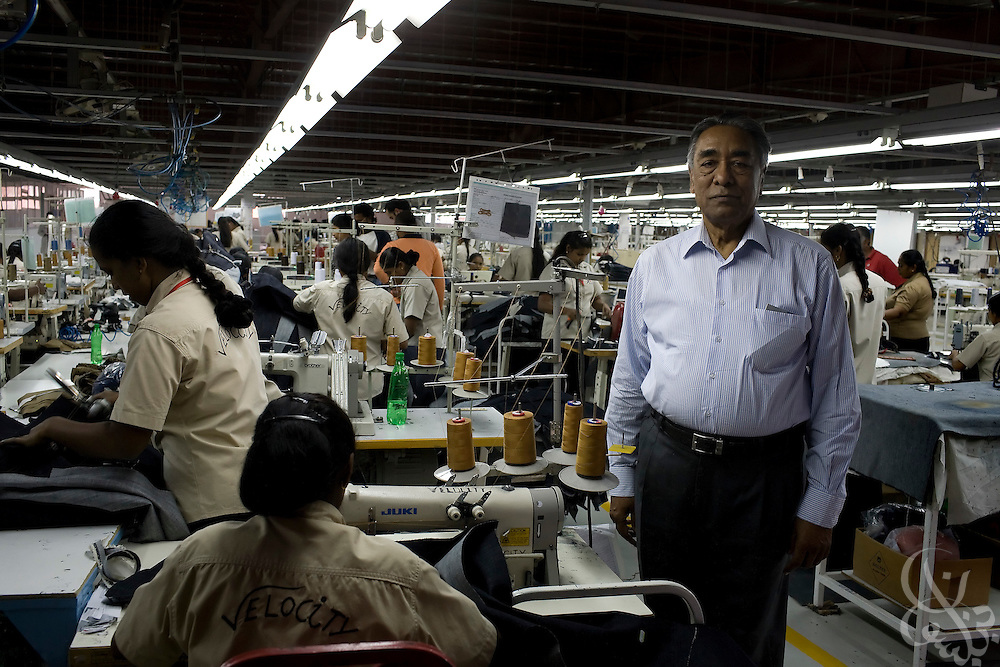 Air Marshal Man Mohan Sinha, chairman of Velocity Apparelz CO visits some of his Sri Lankan workers as they operate a production line for blue jeans at the Velocity Apparelz CO factory October 27, 2008 in Ismailia ,130 kilometers north of Cairo, Egypt.  The Indian owned jeans company has been open in Egypt since 2001, employing 2700 Egyptian workers and several hundred other foreign workers while supplying jeans to major companies that include Levis, Gap, Target, and Zara.