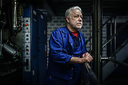 Rudi Vogel is standing in the staicase of a rotary printig machine on February 21, 2013, aware that his job will be terminated very soon. He was employed with the printing house company for 42 years. photo © peter-juelich.com