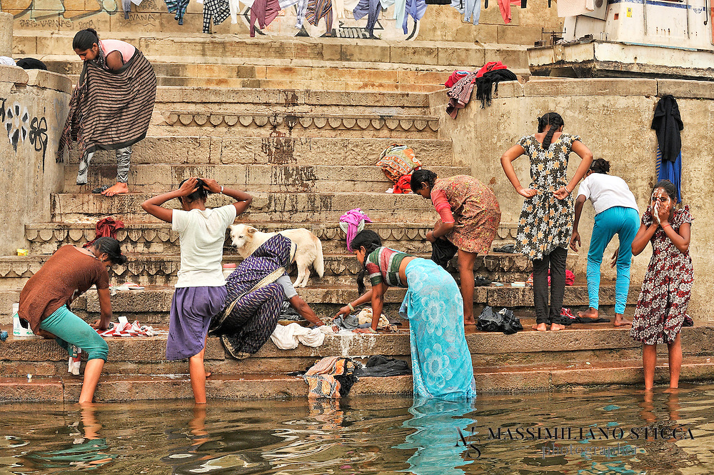 People not only wash their bodies in the sacred waters of the Ganga, but also their clothes.