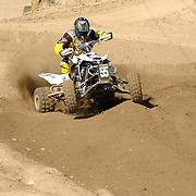 Doug Gust (#55) overshoots the turn and goes off track losing precious time in the qualifier.
