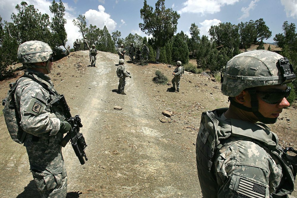 1st August 2007.Bermel, Paktika province, Afghanistan.American soldiers from the 82nd Airborne accompanied by troops from the Afghan Army conduct operations against Taliban insurgents in the region of Bermel, Paktika Province, Afghanistan on the 1st of August 2007. Whilst patrolling the rugged terrain along the Pakistan border the soldiers located a Taliban firing position with several 107mm rockets in place, two were aimed at the US base and connected to a timing device. The rockets were disabled and removed from the site.