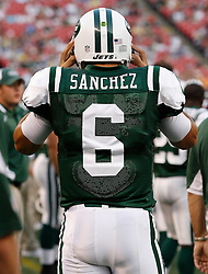Aug 14, 2009; East Rutherford, NJ, USA;  New York Jets quarterback Mark Sanchez (6) gets ready for action during the first half at Giants Stadium.